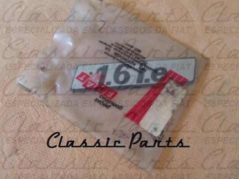 """(7529026) EMBLEMA LATERAL FIAT ELBA/PREMIO/FIORINO """"1.6 I.E."""" ORIGINAL"""
